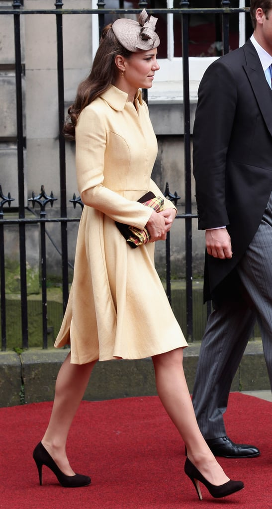 Kate Middleton wore black heels and a yellow dress for Prince William's Thistle Ceremony in Scotland.