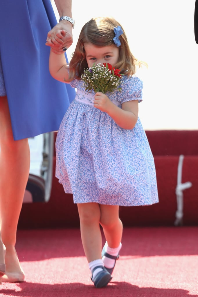 The royal family has been full of sweet moments during their tour of Poland and Germany this week, but Princess Charlotte is definitely stealing the spotlight. After touching down in Berlin, Germany, on Wednesday, the 2-year-old made all of our hearts turn to mush when she sweetly sniffed her bouquet of flowers as she walked hand in hand with mum Kate Middleton. Of course, this isn't the only time Charlotte has proved that she's a total flower girl. She pulled the exact same move during the family's tour of Canada last year when she stopped to smell the roses. She also served as a flower girl in aunt Pippa Middleton's wedding in May. It's official: this little princess is definitely a nature girl.      Related:                                                                                                           Look Back at Princess Charlotte's Cutest Pictures — So Far!