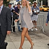 Cameron, and her wondrous stems, in cool Elizabeth and James neutrals and nude heels.