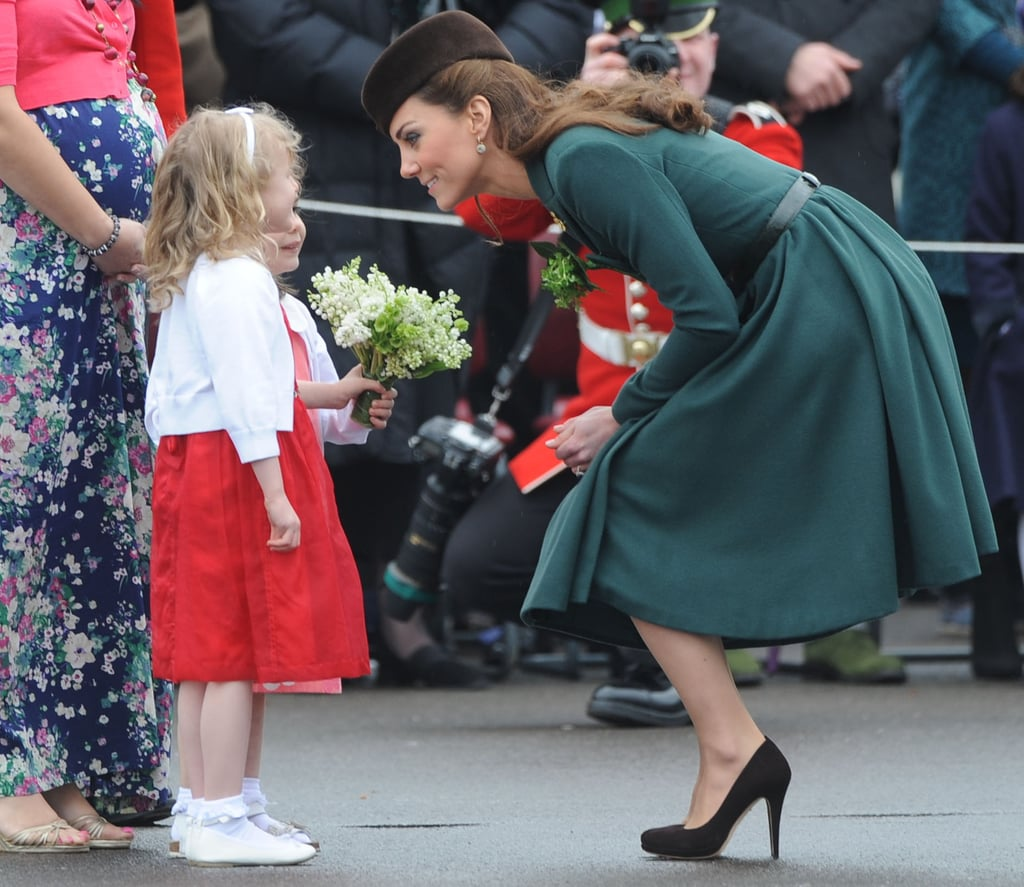 She bent down to chat eye to eye with a young fan in Aldershot, England, on St. Patrick's Day in 2012.