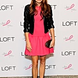 Nikki Reed was a vision in bright pink, wearing a LOFT drop-waist dress with a leather jacket, Tibi ankle-strap sandals, and a Stark box clutch.