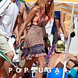 Blake Lively filmed an LA beach scene for Savages in September 2011 wearing a red bikini top.