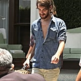 Miley Cyrus followed behind friend Cheyne Thomas, who carried her luggage to the car in Miami.