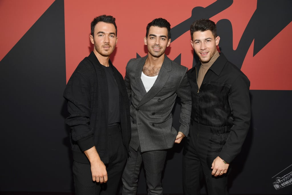 "It's been a hot minute since the Jonas Brothers attended the MTV VMAs together, but they made their big return to the show on Monday night. Kevin, Joe, and Nick looked dashing in colour-coordinated suits as they walked the red carpet together in their home state of New Jersey.  It's certainly going to be a big night for the brothers. Not only are they up for a handful of awards, but they're also set to share the stage for a special performance. The last time the Jonas Brothers attended the ceremony was all the way back in 2008 when they gave a show-stopping performance of ""Lovebug."" Even though a lot has changed since then, they're still making us swoon a decade later.       Related:                                                                                                           The Jonas Brothers' Crazy Evolution Will Make You Feel Like a Teenager Again"
