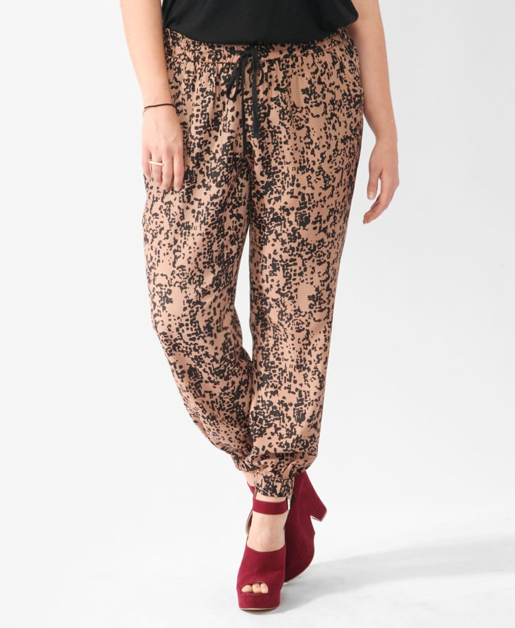We love how these loose pants look when styled with ankle-strap heels (another seasonal trend we love). Forever 21+ Ink Blot Print Joggers ($20)