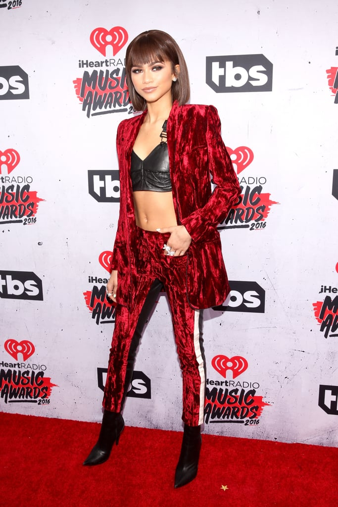 The red carpet got a whole lot sexier when Zendaya arrived at the iHeartRadio Music Awards in LA on Sunday evening. The singer turned heads in a red velvet suit complete with a leather bralette and was the epitome of cool while posing for pictures with singer Diane Warren. Despite not taking home any trophies, the 19-year-old Disney star was up for the triple threat award, a new category dedicated to stars who can sing, act, and dance. Read on for more of Zendaya's sexy night, and then check out even more star-studded arrivals.