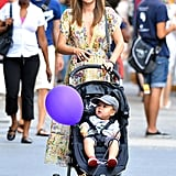 In July 2012, baby Flynn held onto a purple balloon while out and about in NYC with Miranda Kerr.