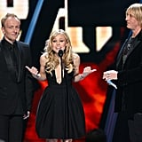 Kristen Bell presented the rock single award with Def Leppard in December 2006.