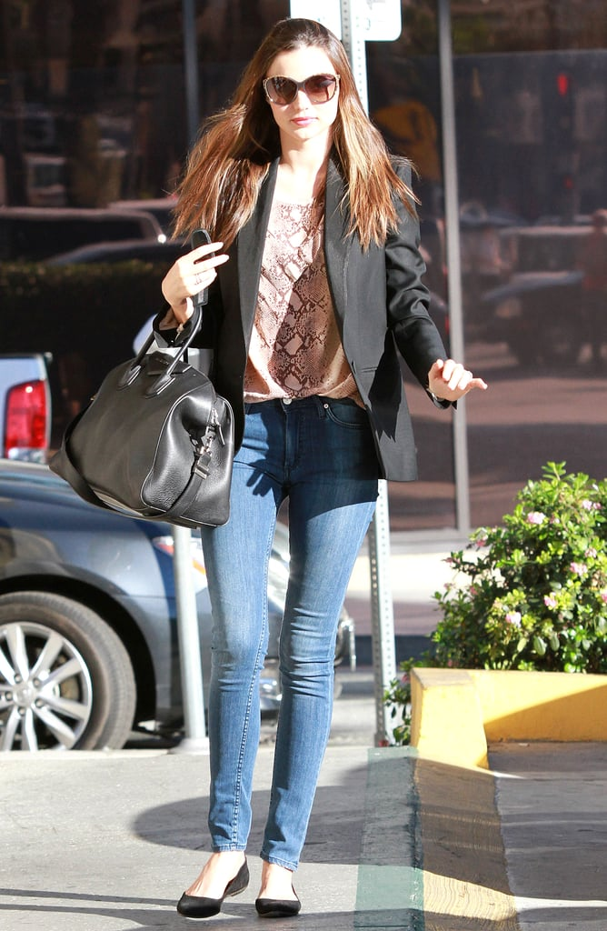 Miranda made a salon stop in an Equipment blouse (this time in a saucy snakeskin print) with skinny jeans and a black Givenchy tote.