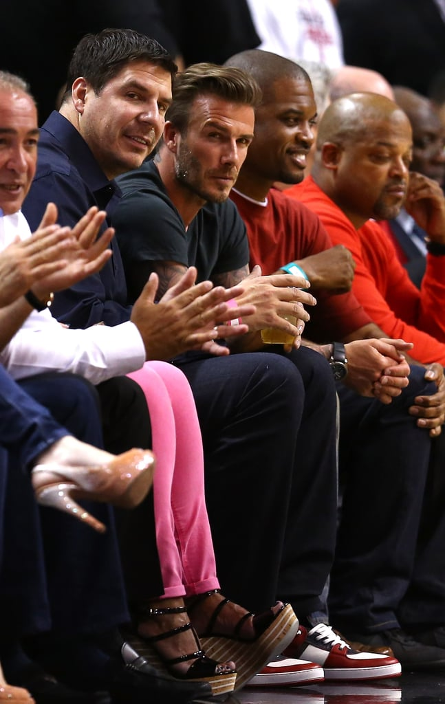 David Beckham sat courtside at the Miami Heat game in Miami.