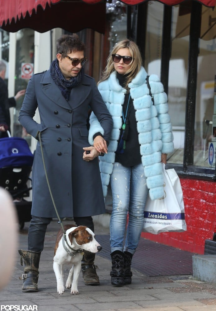 Kate Moss held hands with Jamie Hince while walking the dog in London.