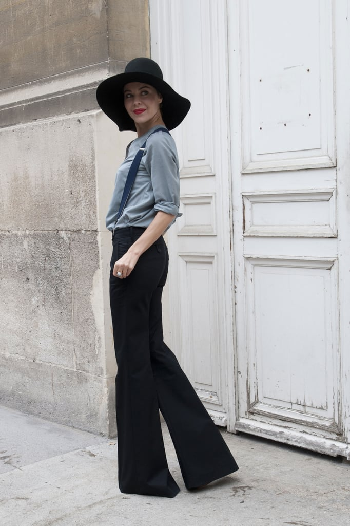 Ulyana Sergeenko added interest with a floppy hat — and mastered the street style pose.