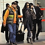 Ashton Kutcher and Demi Moore Stay Attached as They Land in Europe