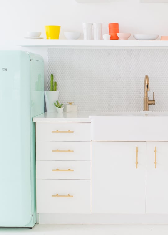 The former mermaid would love this bright pop of seafoam green in her kitchen.