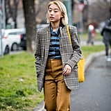A plaid blazer smartens up a striped top for work.