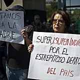 "During the demonstration in Mexico City, a woman held a sign saying ""Very, very indignant due to the resounding collapse of the country."""