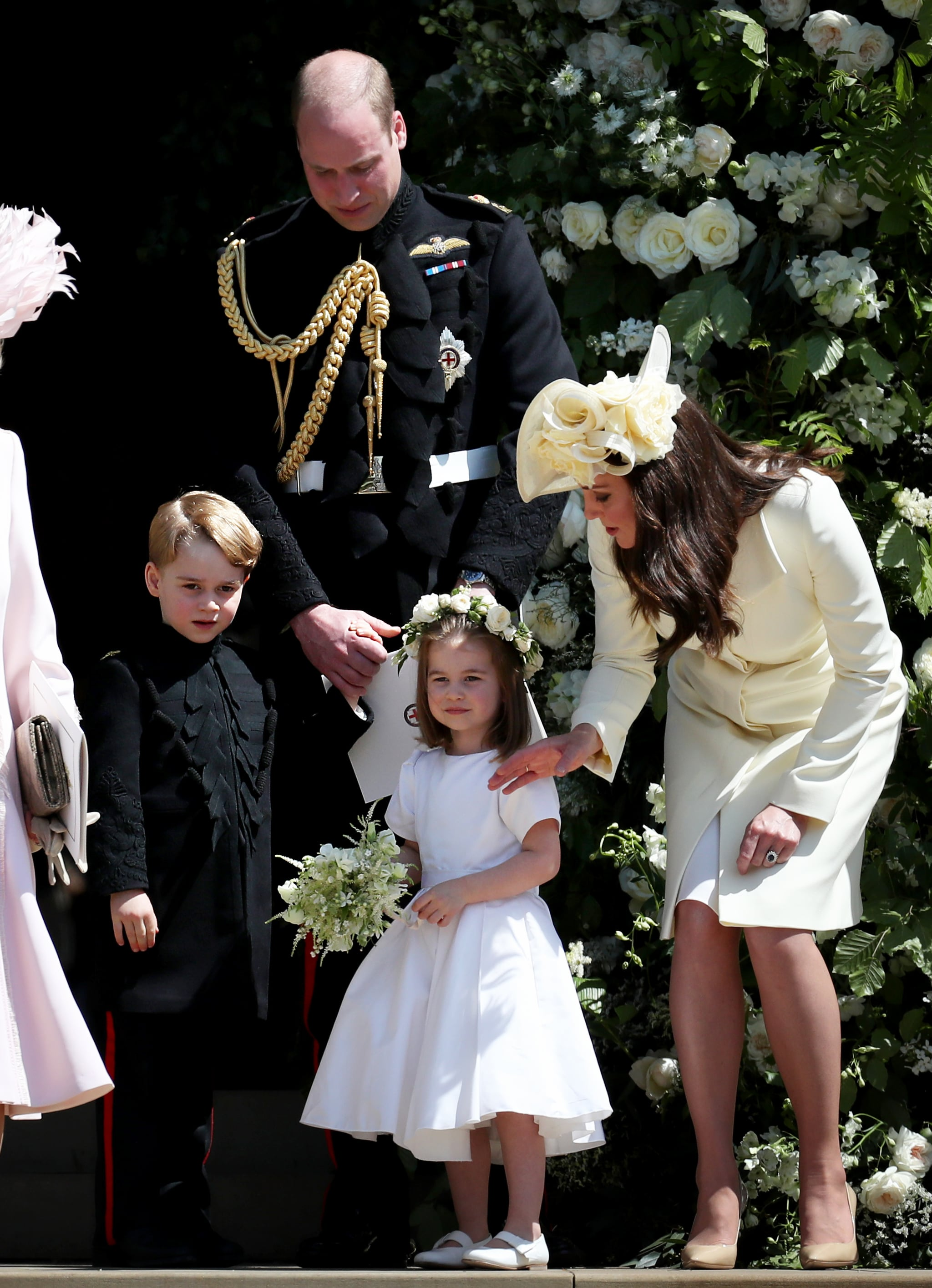 WINDSOR, UNITED KINGDOM - MAY 19:  Prince George of Cambridge, Prince William, Duke of Cambridge, Princess Charlotte of Cambridge and Catherine, Duchess of Cambridge  after the wedding of Prince Harry and Ms. Meghan Markle at St George's Chapel at Windsor Castle on May 19, 2018 in Windsor, England. (Photo by Jane Barlow - WPA Pool/Getty Images)