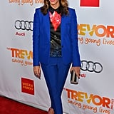 Rashida Jones layered her Peter Pilotto button-up blouse with a bright blue pantsuit and hot-pink heels in December 2012.