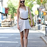 There's nothing wrong with the basics. Just rework a white tunic tank with a belt, then finish with a pair of tough-girl booties and aviators for an easy off-duty look. Source: Le 21ème | Adam Katz Sinding