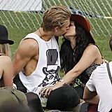 Vanessa Hudgens and her boyfriend Austin Butler kissed in the grass on Friday.