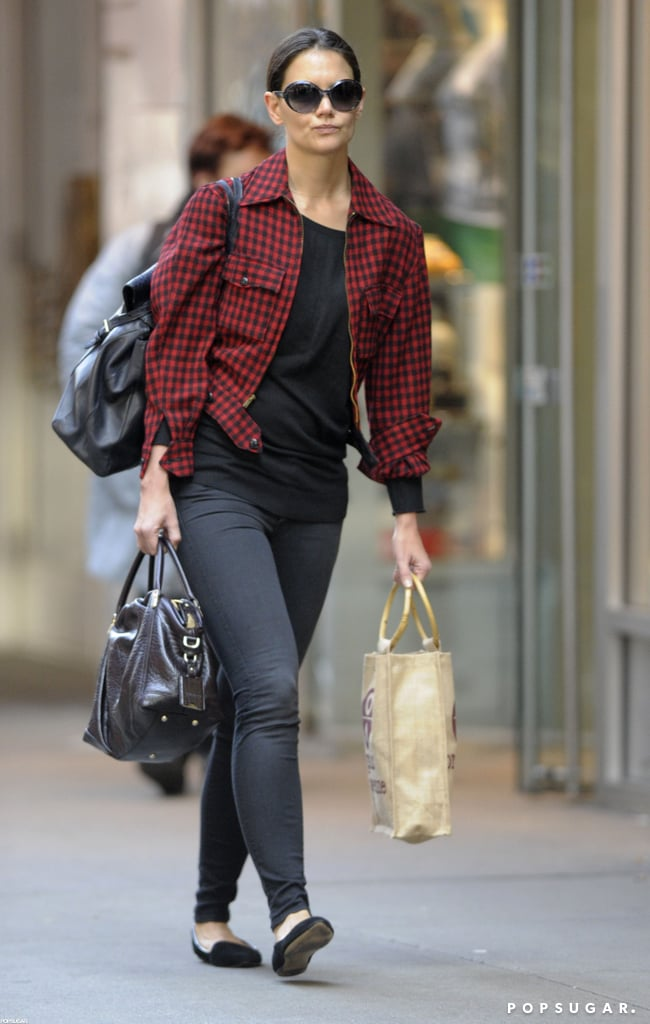 Katie Holmes donned a plaid jacket for an early-morning outing in NYC today. She had her hands full, having picked up items at Organic Avenue. Katie's been juggling Suri's school runs with prepping for her return to Broadway in Dead Accounts. Katie and costar Norbert Leo Butz joke around in a cute promotional video, giving us a sneak peek at their onstage chemistry. Katie's been all about fun and games lately —she was spotted cracking up while out with a friend earlier this week.