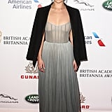 For the British Academy Britannia Awards, Emilia wore a beautiful strapless dress and black cape.