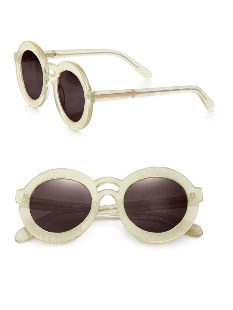 45e8a727f8 The subtle glitter frames of these Karen Walker Joyous Plastic Round  Sunglasses ($250) are