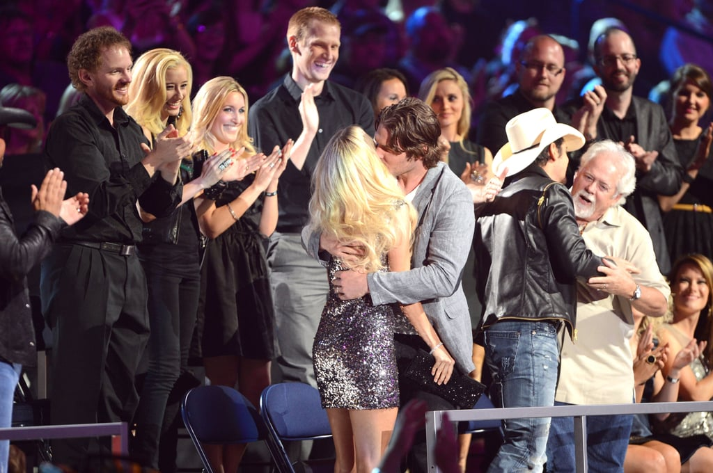 Carrie Underwood and Mike Fisher embraced in the crowd during the June CMT Awards in Nashville.