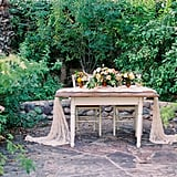 Have your guest book signed at a table topped with flowers.