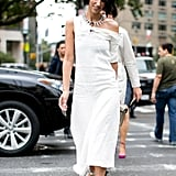 You can make the most subtle statement with a dress that's pulled off the shoulder, just a touch. All eyes on you when you're walking proud in metallic platforms like Yasmin Sewell.
