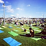 Trying to break the record for the world's biggest yoga class. Source: Instagram user popsugarau
