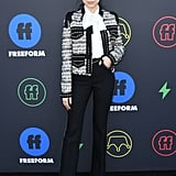 Wearing a blouse, jacket, and black pants by Giambattista Valli at the 2019 Freeform Summit.