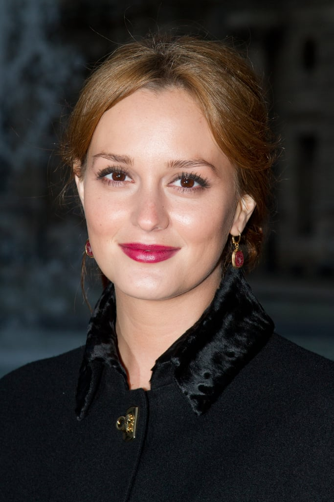 Leighton Meester wore bright lips to the Salvatore Ferragamo Resort collection show in Paris.