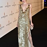 Milla Jovovich showed off her gilded Prada gown.