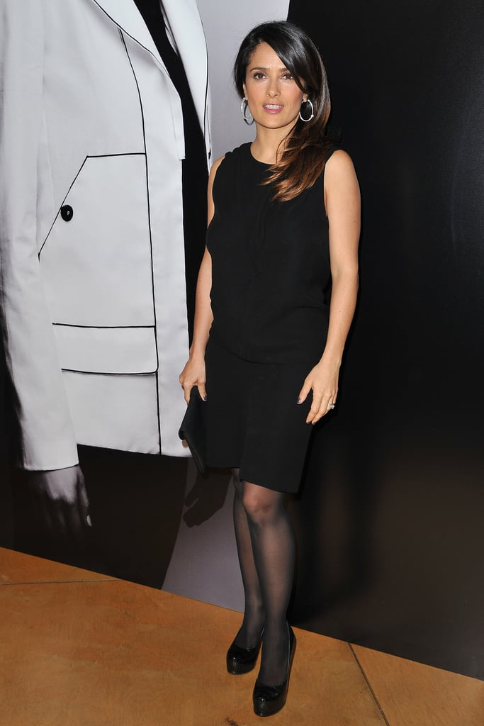 Salma Hayek looked polished in a LBD with matching platform pumps and oversized earrings the Hogan presentation.