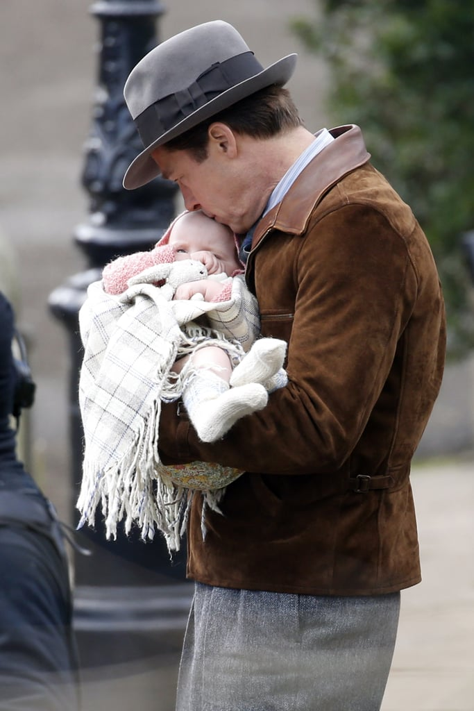 Brad Pitt and Marion Cotillard hit the set of their new film, Five Seconds of Silence, in London on Thursday. The pair were spotted shooting scenes with a super cute baby girl, and Brad played the role of doting dad — something we're sure he's got lots of experience with — by cradling the little one and carrying her high on his shoulders as Marion held on to a picnic basket. The romantic thriller, which is being directed by Robert Zemeckis, is reportedly set during World War II and follows a spy who falls in love with a French agent during a mission in North Africa. Last time we saw Brad was in January, when he was wearing a decidedly more modern outfit and putting his charm on display with Ryan Gosling on stage at the Golden Globes. Is it just us, or does he look even younger than he did then? Almost as if he's . . . Benjamin Button-ing himself? Keep reading to see Brad looking youthful and being really, really sweet with a baby on set, then stream some of his best movies on Netflix.