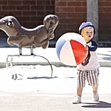 Luca Comrie held on to a beach ball.