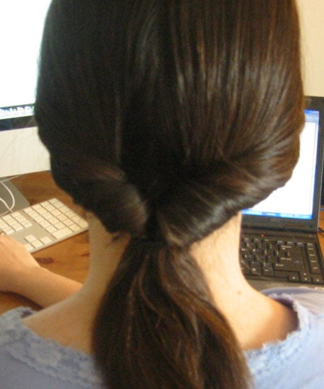 Pull ponytail outwards to tighten.