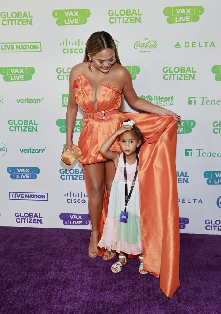 See Chrissy Teigen's Orange Dress at Global Citizen Vax Live