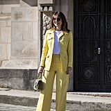 Balance out a colorful suit with a white t-shirt and simple heels.