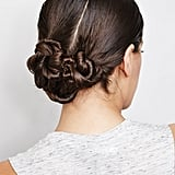 When you just can't be bothered to blow-dry your mane after spin class, pull your wet strands into this twisted low chignon. Though it looks complex, it's actually a breeze to create. Learn how to DIY it here.