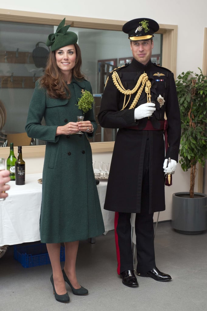 "Kate Middleton and Prince William still had their island tans when they participated in their annual St. Patrick's Day tradition of visiting the Irish Guards in Aldershot, England, on Monday. This is the Duchess of Cambridge's third time taking part in the festivities, but she changed things up a bit this time around by ditching her usual green Emilia Wickstead coat (which she had worn two years in a row) for a festive Hobbs coat and matching Gina Foster hat. She also kept with her new ""princess"" makeover by accessorizing with a Cartier shamrock brooch which was first worn by Queen Alexandra, the consort of King Edward VII. The duke and duchess pinned shamrocks onto the guards, including their Irish wolfhound mascot, Domhnall, who got a bonus pat on the head from Kate.  Kate and William are fresh off their parents-only vacation to the Maldives. Their trip was met with a bit of controversy, as some felt that it was inappropriate for them to leave their 8-month-old son, Prince George, at home, despite the fact that he was staying with Kate's parents. However, George has been getting lots of travel time with his mom, and she took him on a Middleton family vacation to their favorite relaxation spot, Mustique, in early February. At the time, Prince William stayed behind in London as he was in the middle of his 10-week agriculture course at Cambridge University."