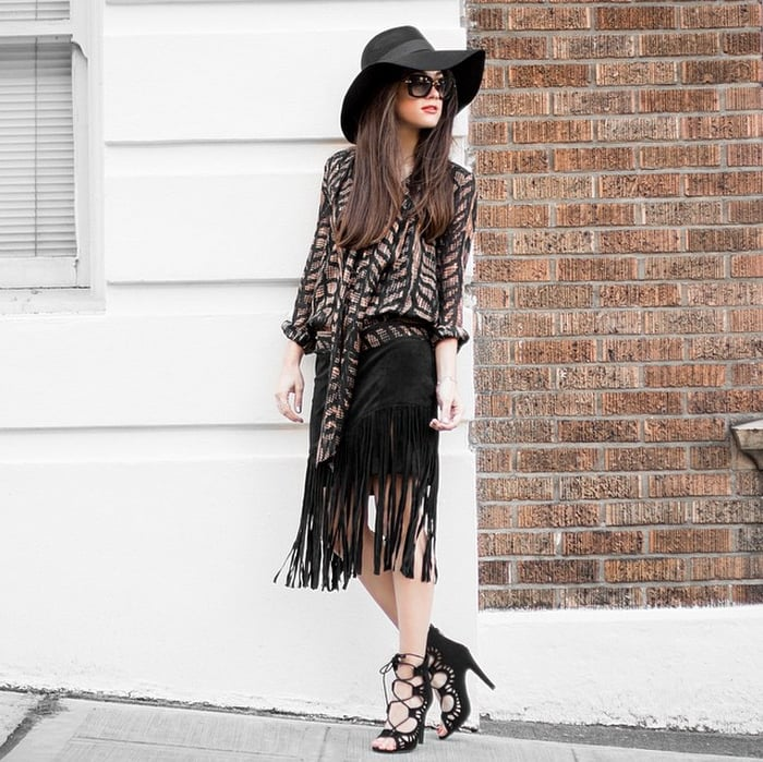 A Chiffon Top, Fringed Skirt, Lace-Up Shoes, and a Hat