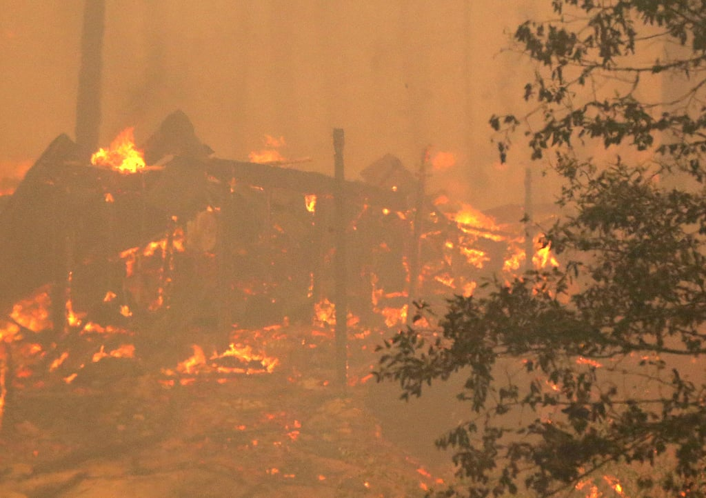 A structure near Yosemite National Park was consumed by the fire.