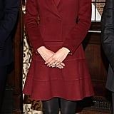 Kate Middleton wore black tights and pumps.