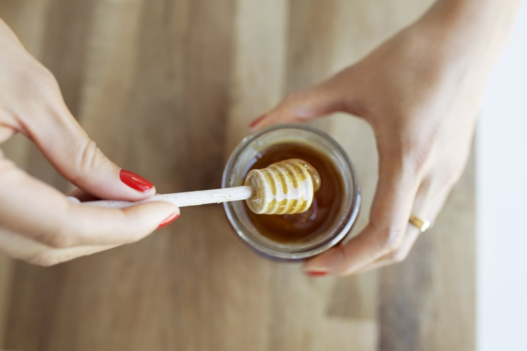 Adding honey to hair conditioner for softer tresses.