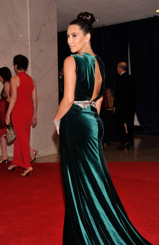 Kim Kardasian wore a long green dress on the red carpet.