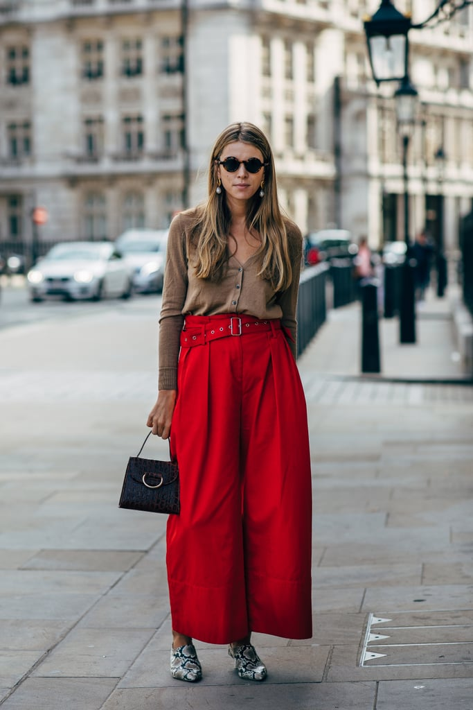Brown and bright red meet in perfect harmony when you're accessorizing with any kind of animal print — be it on your shoes or bag. It would be smart to invest in an easy cardigan in a color like this one.