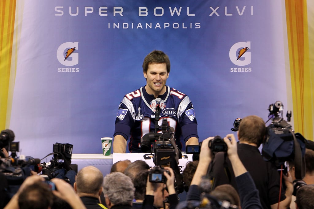 Tom Brady put on a Patriots jersey for a press conference about Super Bowl XLVI in Indianapolis yesterday. He was back in front of the cameras today to talk about the big game with a few teammates and head coach Bill Belichick. While Tom is prepping for Sunday's matchup against the NY Giants, his wife Gisele Bundchen has been sticking close to home in Boston. She's been spotted running errands and picking up groceries, though she should soon be making the trip to Indiana to cheer on her man. Gisele traveled to Arizona for the 2008 Super Bowl, which Tom lost to Eli Manning and the Giants. Tom and Eli will go head to head again this Sunday, but the football day isn't just about what happens on the field. There are plenty of exciting commercials to look forward to including David Beckham's underwear ad for H&M and Adriana Lima's lingerie spot for Kia.