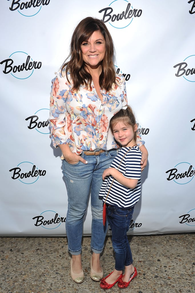 Tiffani Thiessen and her daughter, Harper Smith, shared a slew of adorable moments at the grand opening of Bowlero bowling alley in LA's Woodland Hills on Saturday afternoon. The mother-daughter duo traded in their flats for a pair of bowling shoes, and Tiffani happily looked on while Harper excitedly went for a strike. The former Saved by the Bell actress was even spotted giving her mini me a few pointers and snapping photos on her cell phone. Missing from the fun, though, was Tiffani's husband, Brady Smith, and their nearly 1-year-old son, Holt Smith, whom the actress often photographs — you can catch her shared pics on Instagram. Keep reading to see more of Tiffani and Harper at the bowling alley, and then check out all the reasons Kelly Kapowski is the queen of cool.
